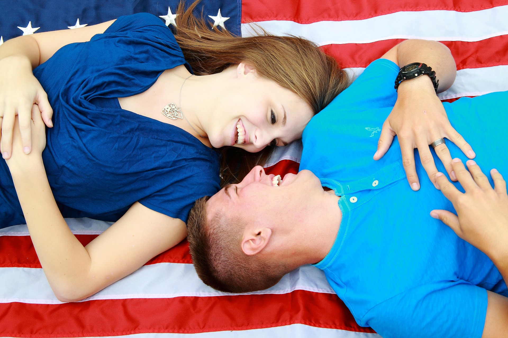 couple lying on an American flag