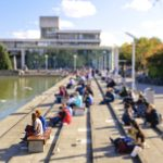 Sunny Autumn day on Belfield Campus – students sitting beside the Belfield Lake